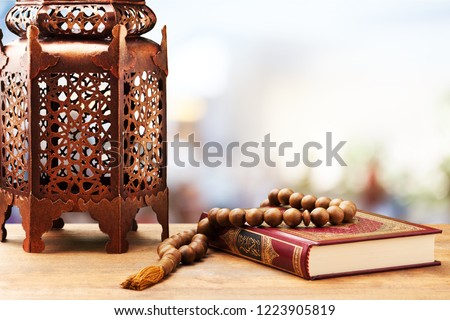 Three months.Islamic Holy Book Quran with rosary beads under soft light on White Background. Ramadan concept . #1223905819