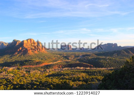 Rock formations in a valley with mountains near Sedona, AZ. #1223914027