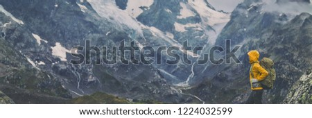 Mountain hike Europe travel hiker woman trekking in Switzerland Alps mountains landscape background. Panoramic banner of hiker on adventure trek. #1224032599