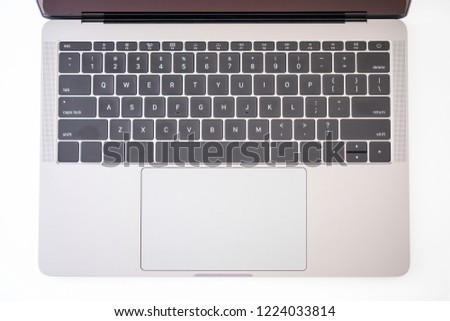 Keyboard on a modern laptop computer with a macro lens #1224033814