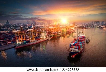 Logistics and transportation of Container Cargo ship and Cargo plane with working crane bridge in shipyard at sunrise, logistic import export and transport industry background #1224078562
