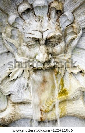 Water spitting gargoyle in Leopold Fountain, Innsbruck #122411086