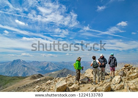 Leadville, CO / USA - August 10, 2018: Hikers at the summit of Mt. Elbert, the highest point in Colorado at over 14,000 feet. Climbing all of the 14ers in Colorado is on many peoples bucket list. #1224133783
