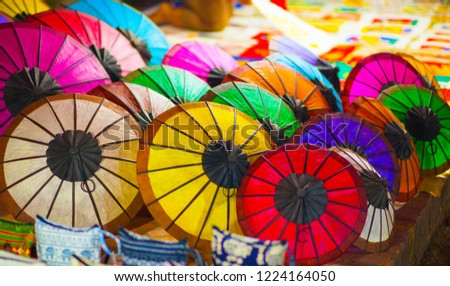 Colorful patterns, miscellaneous items In the night market Luang Prabang, Laos. Royalty-Free Stock Photo #1224164050