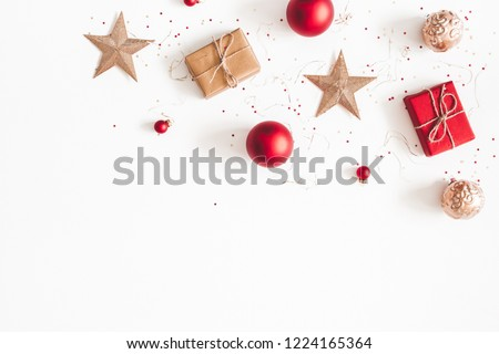 Christmas composition. Christmas gifts, red and golden decorations on white background. Flat lay, top view, copy space #1224165364