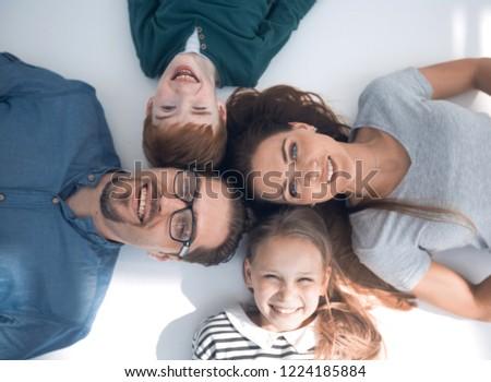 top view. happy parents with children lying on the floor #1224185884