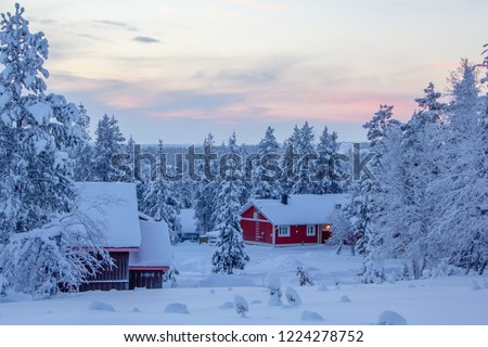Winter landscape scenery in Lapland, Scandinavia with snow and traditional houses #1224278752