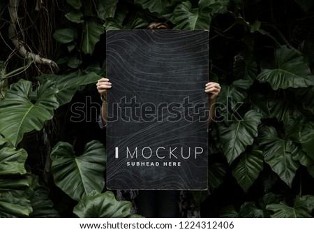 Female in a tropical background holding a signboard mockup #1224312406