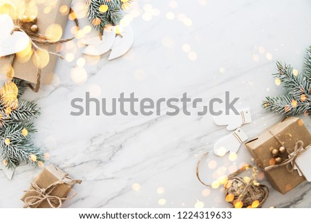 Christmas handmade gift boxes on white marble background top view. Merry Christmas greeting card, frame. Winter xmas holiday theme. Happy New Year. Noel. Flat lay Royalty-Free Stock Photo #1224319633