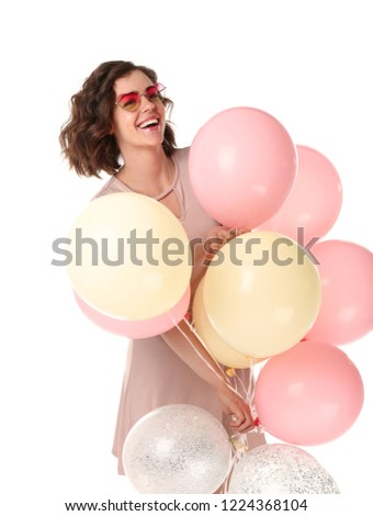 Beautiful young woman with air balloons on white background #1224368104