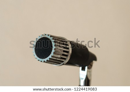 An old and rustic microphone  #1224419083