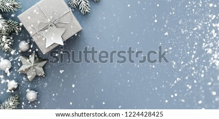 Christmas silver handmade gift boxes on blue background top view. Merry Christmas greeting card, frame. Winter xmas holiday theme. Happy New Year. Flat lay #1224428425