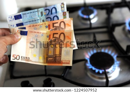 increase in the cost of the gas bill - euro money and gas stove turned on #1224507952