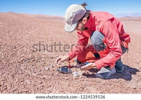 Atacama desert, the driest desert in the world. Its old sand slopes keep lands from millions of years ago what makes easier to find meteorites on the ground. A meteorite hunter man doing his work