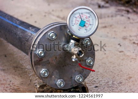Hydrostatic testing for polyethylene pipeline and view of the manometer  according to EN 837-1 Standard with the calibrated at pressure. Psi ( Bar ) is a pressure unit. #1224561997