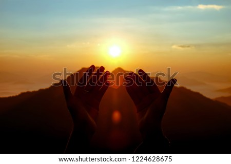 two hands of muslim who praying for hope and successful in sunrise. Use for Al-quran Quote background  #1224628675