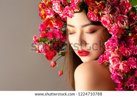 korean woman with bright makeup and roses on head closeup #1224710788