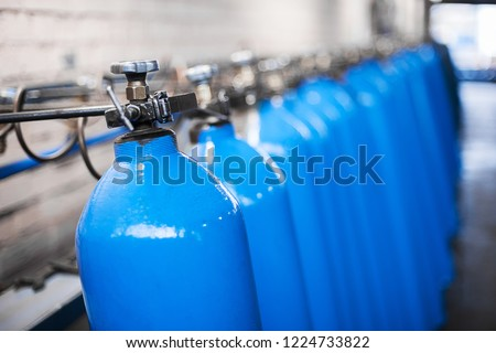 Oxygen cylinder with compressed gas. Blue Oxygen tanks for industry. Liquefied oxygen production. Factory #1224733822