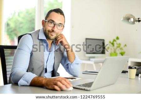 portrait of handsome trendy casual mid age business man in office desk with laptop computer  #1224769555