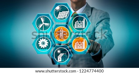 Utility manager feeding the electricity of a battery storage power station into the renewable energy grid. Industry concept for BESS, ESS, grid stabilization and reliability, electric feed-in. #1224774400