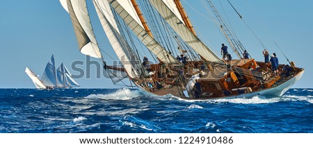Sailing ship race. Classic yacht under full sail at the regatta #1224910486