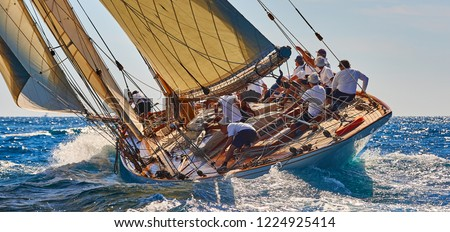 Sailing yacht race. Sports team of yachtsmen is fighting to win the regatta Royalty-Free Stock Photo #1224925414