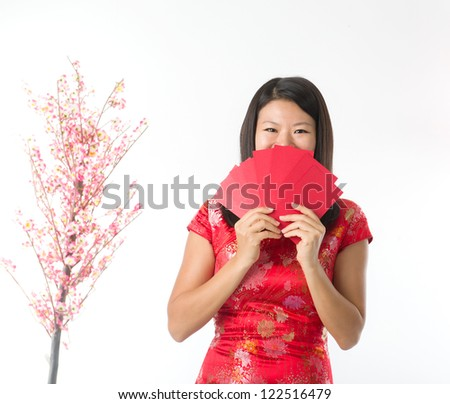 Happy Chinese new year asian girl. Asian girl holding ang pao #122516479
