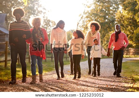 Multi Generation Family On Autumn Walk In Countryside Together #1225231012