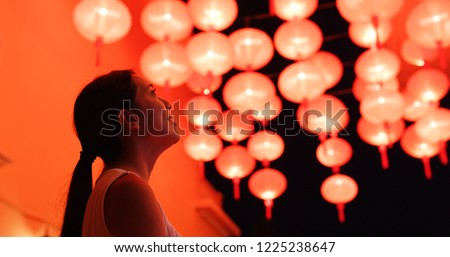 Woman look at the red lantern for Chinese new year #1225238647