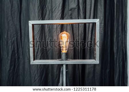 Decorative lamp in a pentagonal frame