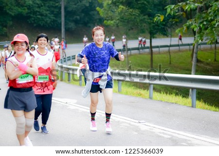 Chiang Rai THAILAND-9:29:2018: MFU RUN 2018 in Mae Fah Luang University Chiang Rai Thailand.People. Running at city streets. #1225366039
