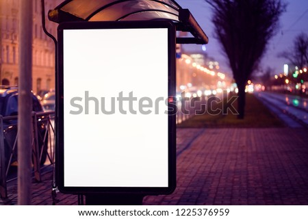 train stop bus shelter, with advertising billboard light advertisement for advertising. outdoor advertising luminous in the night city. layout for advertising. empty white field. bus stop #1225376959