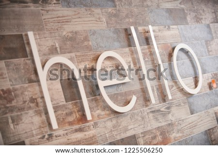 hello welcome sign on fake wood background