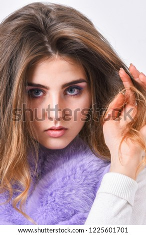 Hair care concept. Girl fur coat posing with hairstyle on white background. Prevent winter hair damage. Woman makeup face touch hair volume hairstyle. Winter hair care tips you should follow. #1225601701
