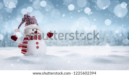Panoramic view of happy snowman in winter scenery with copy space #1225602394