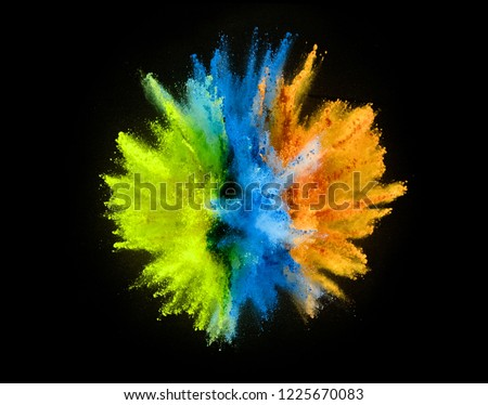 Colored powder explosion isolated on black background. #1225670083