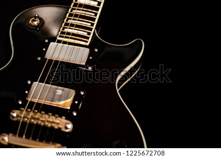 Isolated electric guitar on black background #1225672708