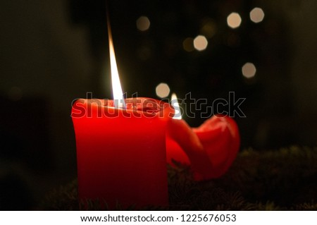 Two Red Candles with Bokeh Balls from a Christmas Tree #1225676053