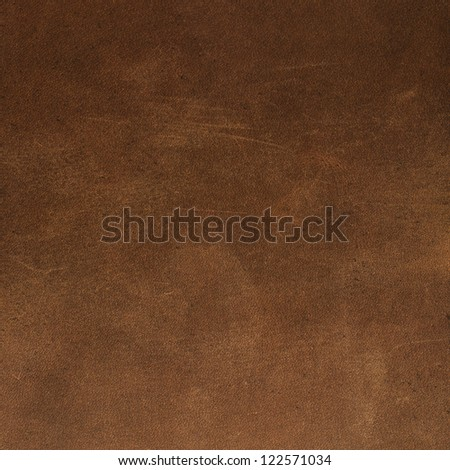 Brown leather texture closeup. Useful as background for design-works. #122571034