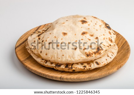 Indian Traditional Cuisine Chapati The Phooli ( Air filled) Roti, Fulka, Indian Bread, Flatbread, Whole Wheat Flat Bread, Chapathi, Wheaten Flat Bread, Chapatti, or Chappathi #1225846345