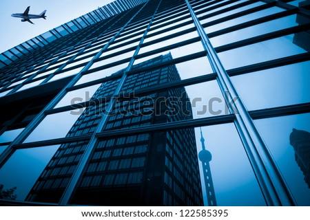 modern blue glass wall of skyscraper #122585395
