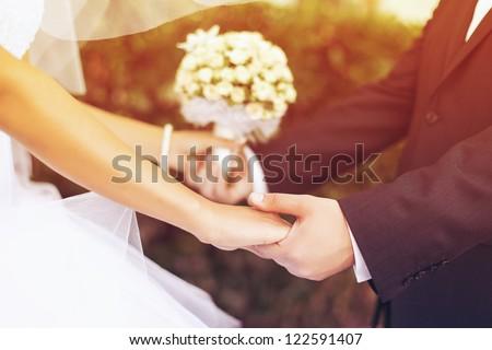 Wedding couple holding hands Royalty-Free Stock Photo #122591407