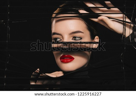 Beautiful woman in black with red lips, closeup. Fashion model, green eyes #1225916227