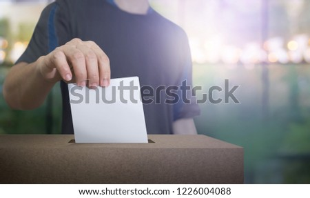 Hand holding ballot paper for election vote at place election background. Election vote concept. #1226004088