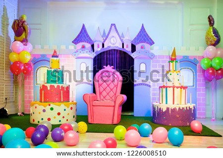 Room for children's birthday, decorated in the form of a Princess castle with a throne and a large number of balloons.