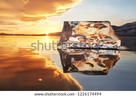 Sunset sky and ice on Lake Baikal. Winter ice on Lake Baikal. Crystal clear drinking water. The floe on Lake Baikal broke away and is reflected in the ice as in a mirror. #1226174494