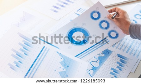 businessman working data document graph chart report marketing research development  planning management strategy analysis financial accounting. Business  office concept. #1226185093