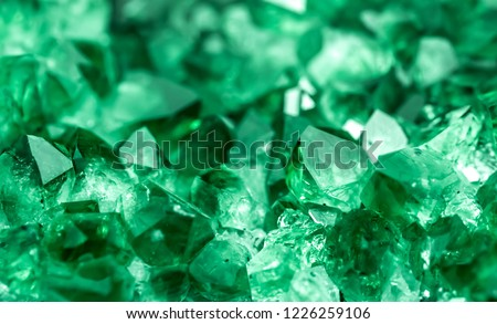 Green crystal mineral stone. Gems. Mineral crystals in the natural environment. Texture of precious and semiprecious stones. Seamless background with copy space colored shiny surface of precious stone #1226259106