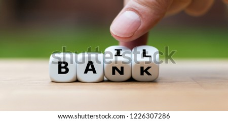 """Hand is turning a dice and changes the word """"Bank"""" to """"Bail"""" #1226307286"""