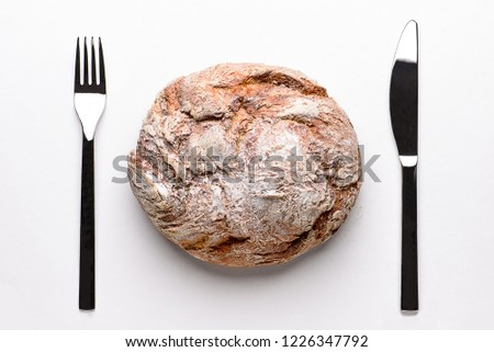 Round embossed bread on a wooden board and white background. View from above. #1226347792